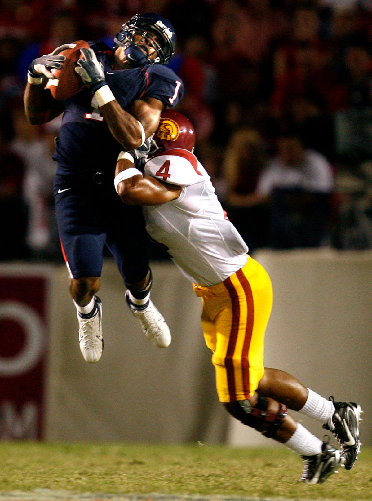 USC's Kevin Ellison puts the hit on Arizona receiver Syndric Steptoe in the third quater in Tucson, Arizona Saturday. Steptoe held on to the catch for a gain.