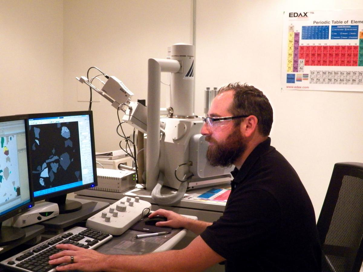 Newmont lab - Dan Lopez with electron microscope