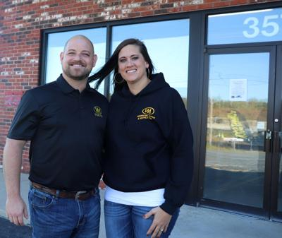 Adam and Nicole Gentry stand outside their business