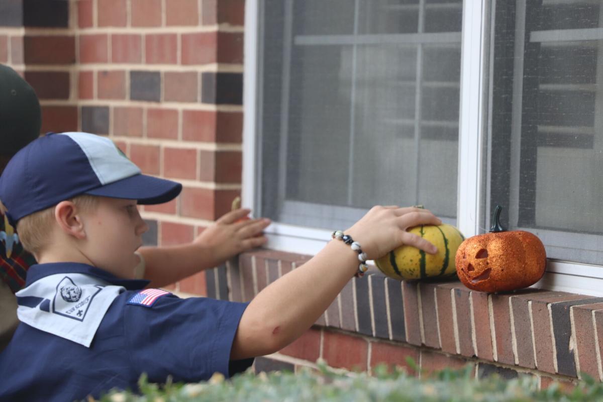 Colton White places a pumpkin