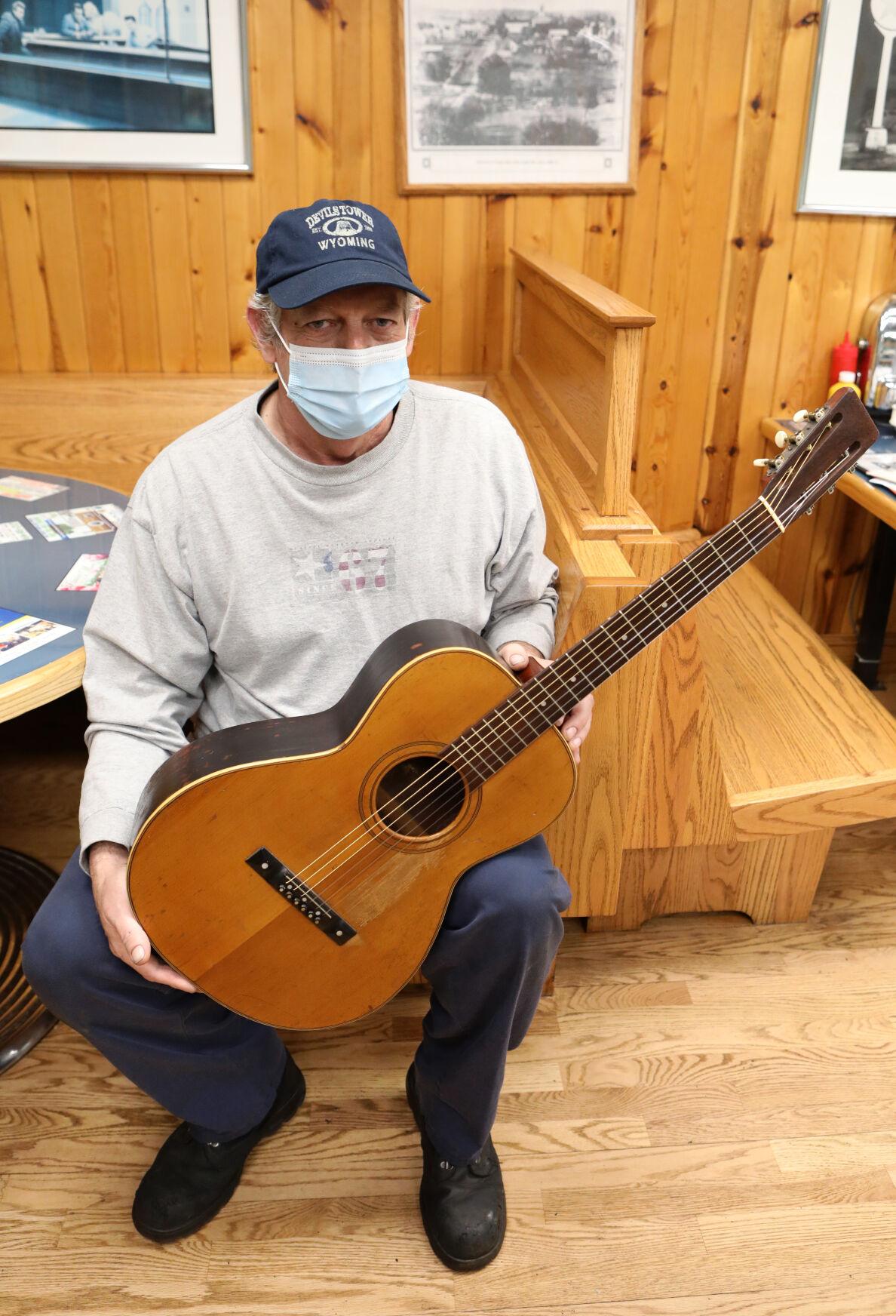 Matt Snodgrass poses with his guitar