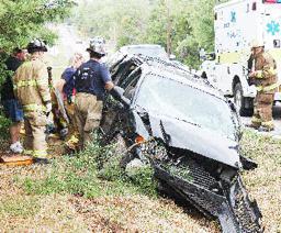Van Strikes Pole, Two Hurt