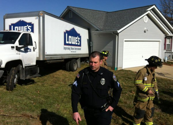Truck Crashes into House