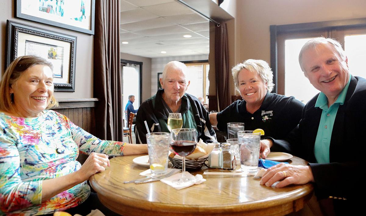 Jean and John Hauser and Bill Zastrow eat at The Hawthorne Inn