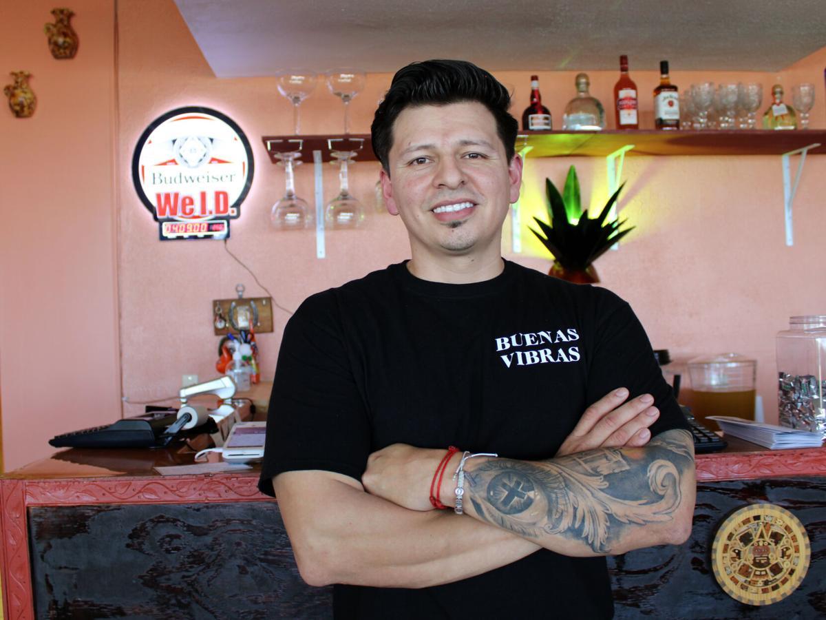 Antonion Hernandez stands in Buenas Vibras