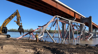 Crews clear bridge scrap