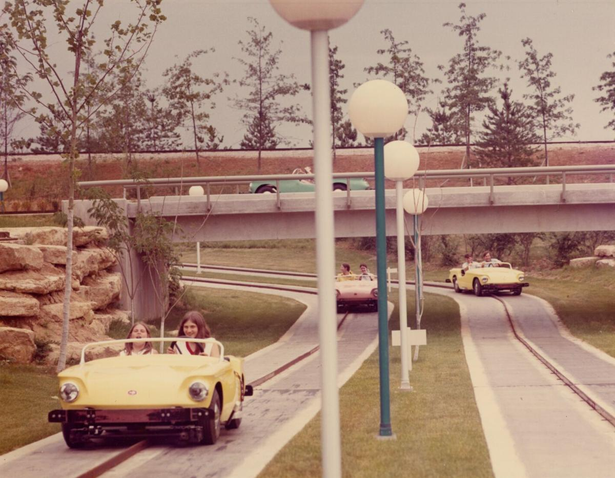 Guests drive through the Super Sports Car Ride