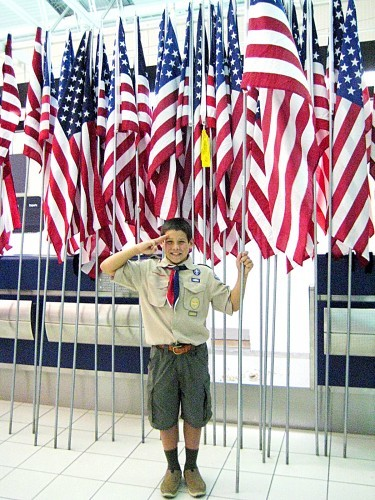 Boy Scout Greets Returning Veterans