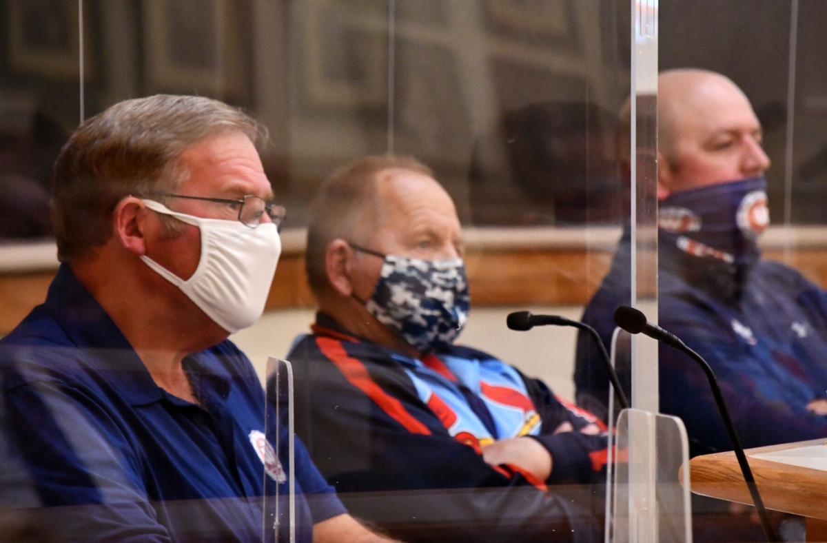 Joe Holtmeier, Greg Skornia and Jeff Patke sit at a council meeting