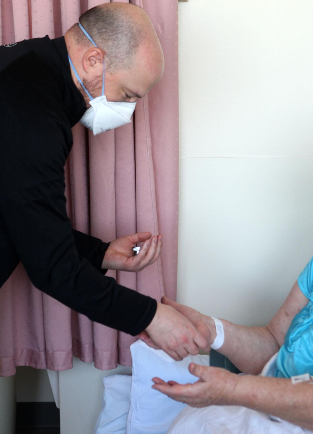 Jim Theby anoints a Mercy Hospital patient