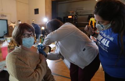 Marty Schenk receives a vaccine from Brooklynn Kliethermes