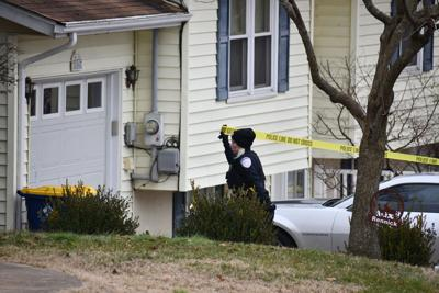 An Officer Puts Up Caution Tape