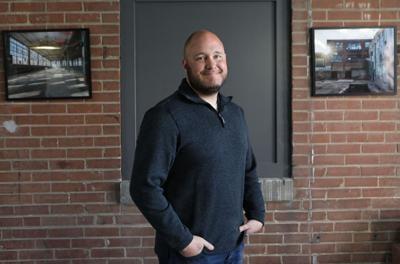 Ed Schmelz stands in Shoe Factory Lofts lobby