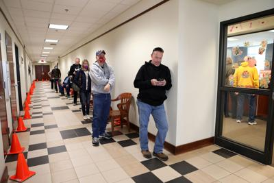 Voters line up outside the county clerk's office