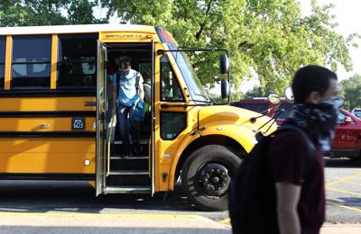 Students climb off the bus