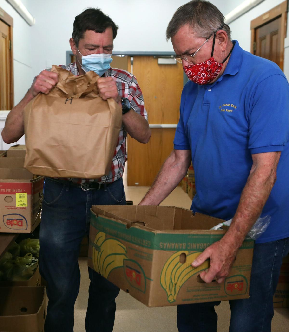 Jim Schwaller and Ron Kuebler pack food