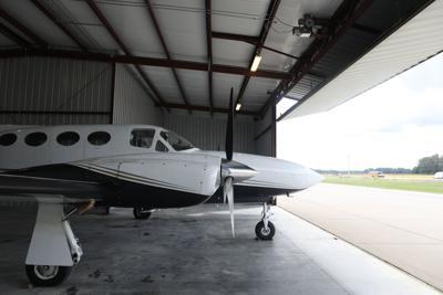 airplane sits in a hangar