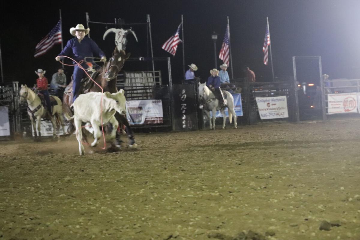 Lindsey Kraus ropes a calf