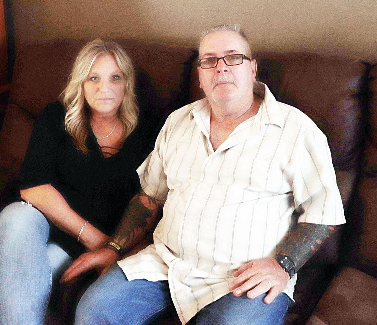 Mike Bursey sits with his wife, Mary