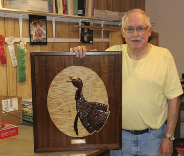 Scrap Wood Artist Counts Three Holes in One to His Name