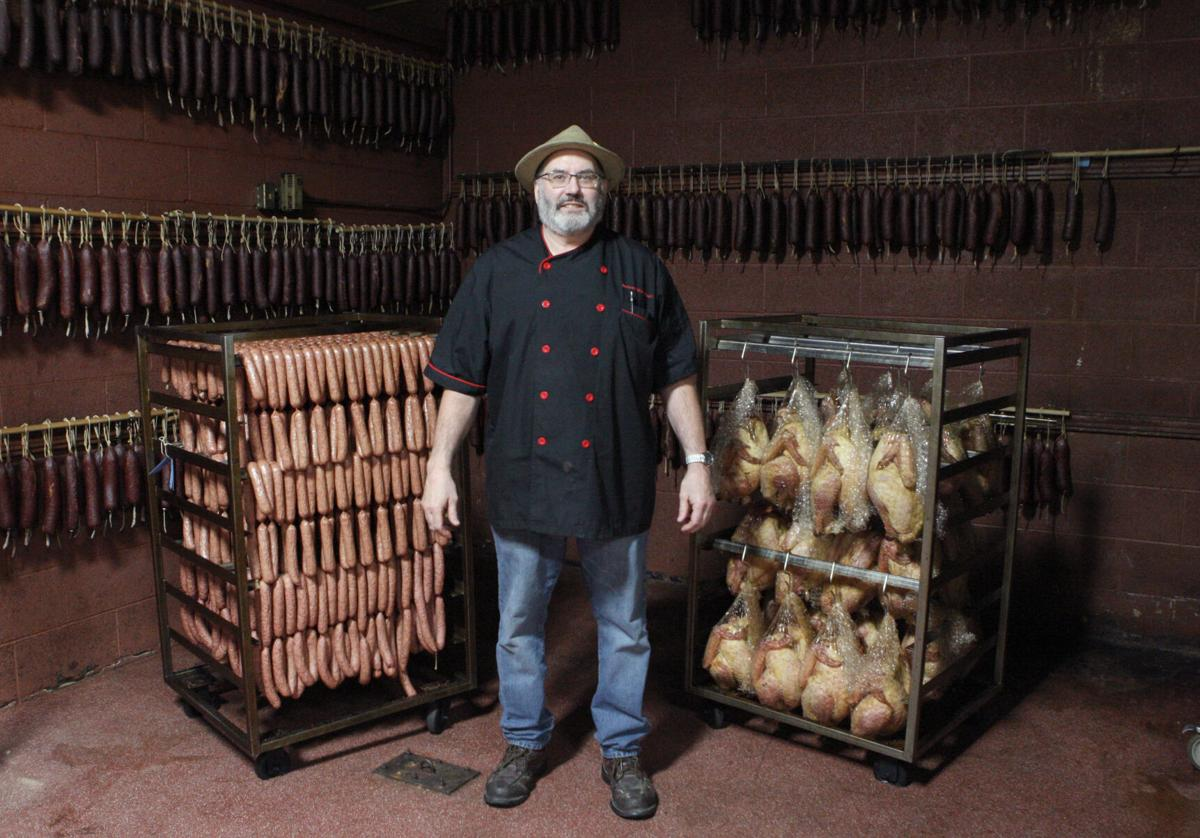 Mike Sloan stands in the Hermann Wurst Haus