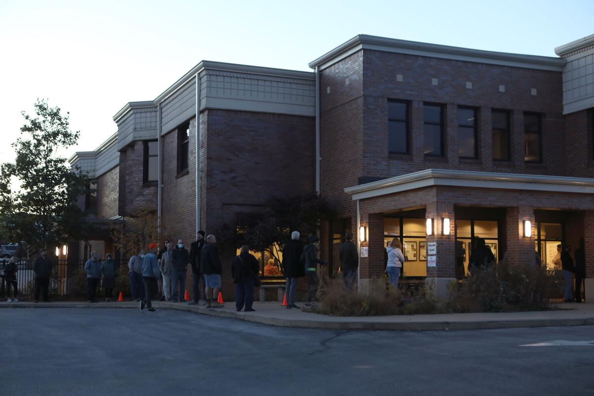 Voters stand in line at the Washington Public Library