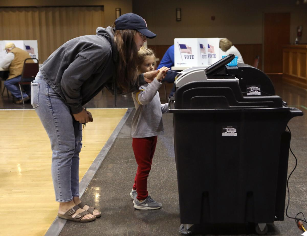 Brittany Nothum and Wynn Nothum submit a ballot