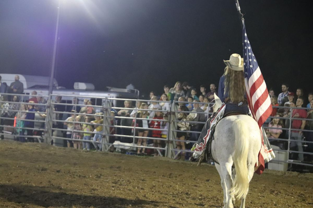 American flag paraded ahead of rodeo