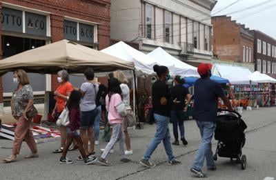 People wander through Fall Festival downtown