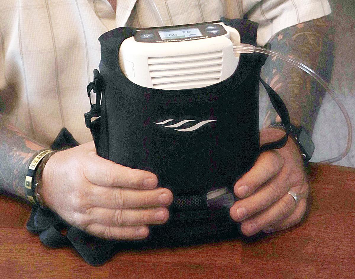 Mike Bursey displays oxygen machine