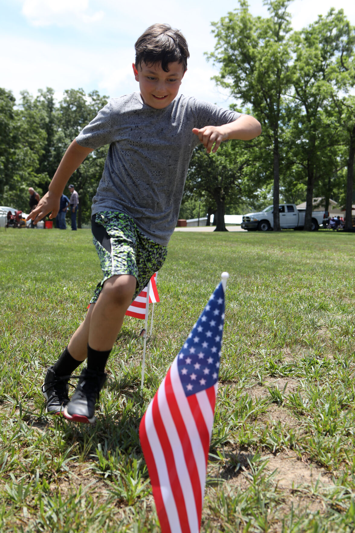 Jeremiah Sikes runs through obstacle course