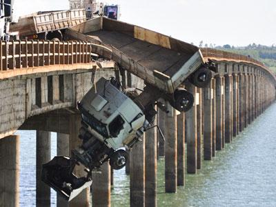 truck dangles off bridge