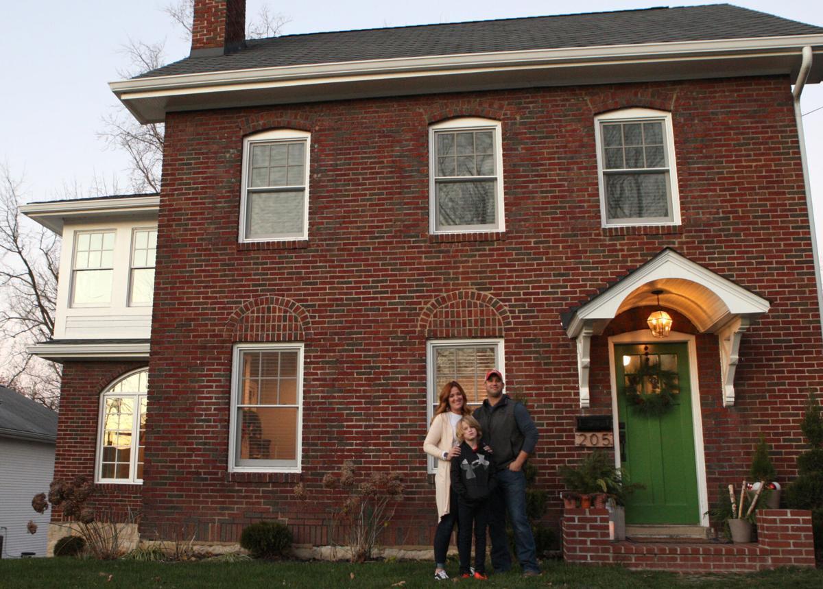 Liz, Lute and Gunnar Cain outside their home
