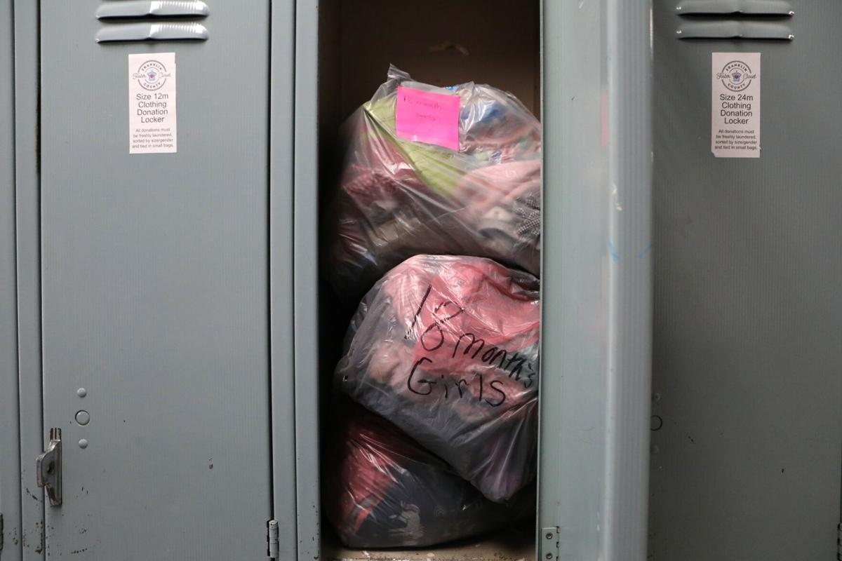 Donated clothes sit in lockers