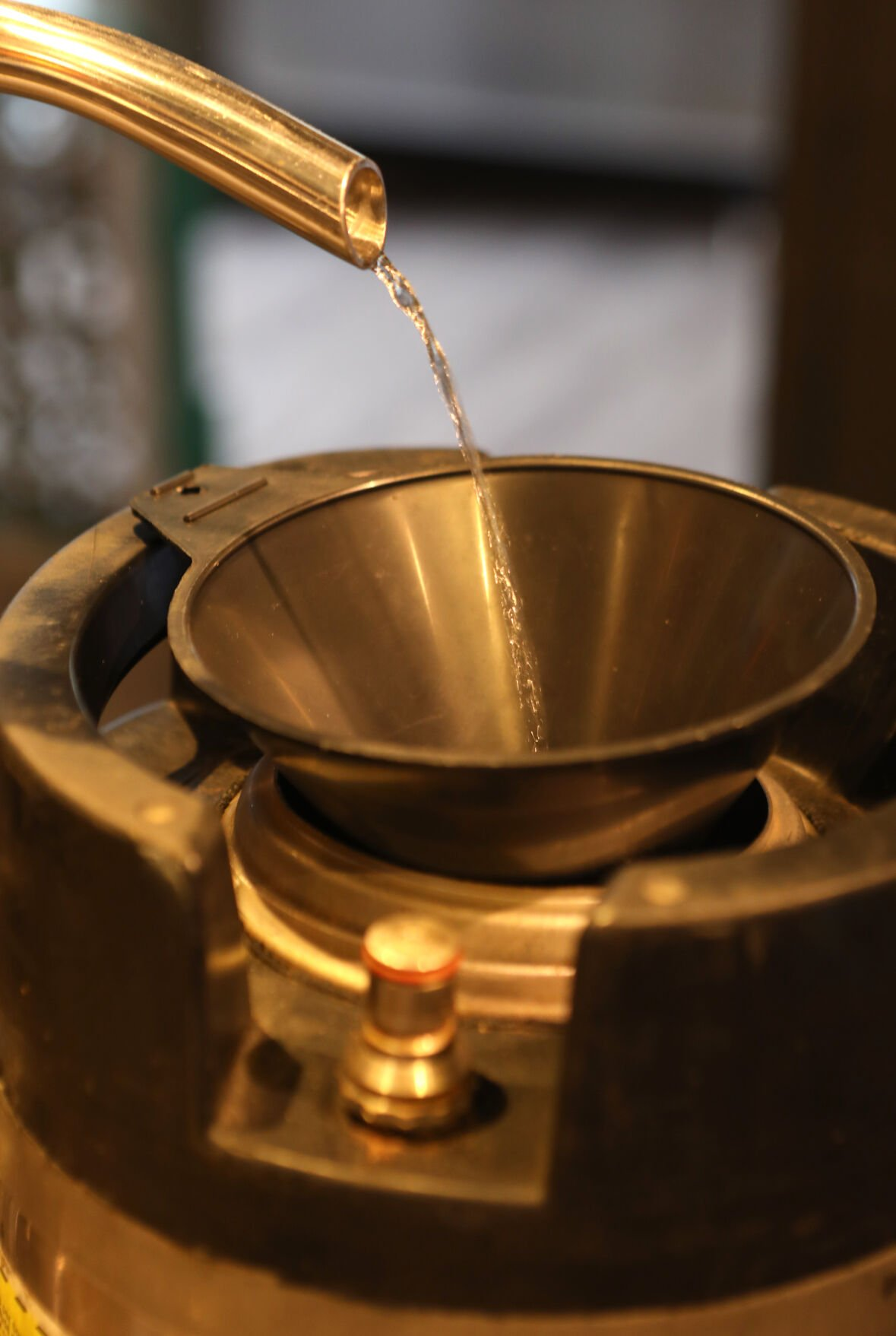 Gin flows out of the distiller