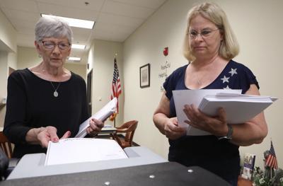 Donna Wissmann and Debi Prichard count absentee ballots