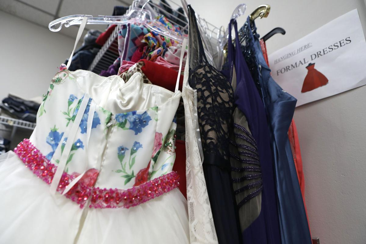 Prom dresses hang with other clothes