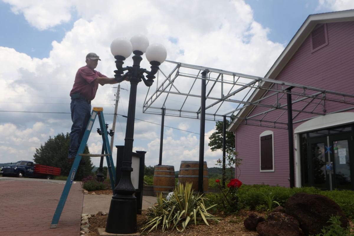 Randy Engemann adds lightbulbs to a lamp