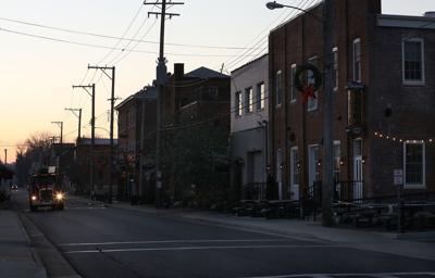A Car Drives Along Front Street