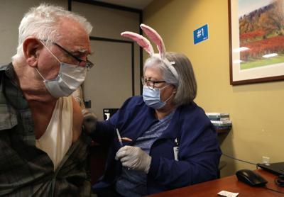 Everett Flaker receives a vaccine from Joyce Sanfilippo