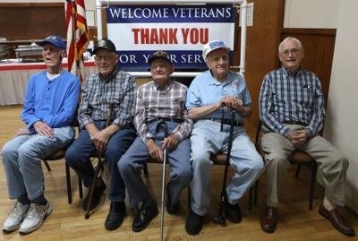 World War II Veterans sit for a portrait