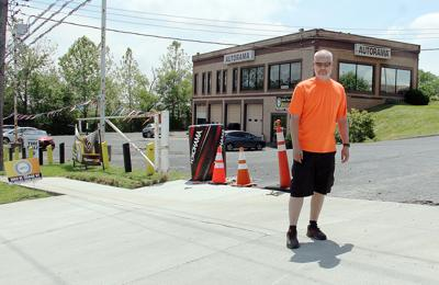 Eric Bratch stands near Phil's Tire Shop in Pacific