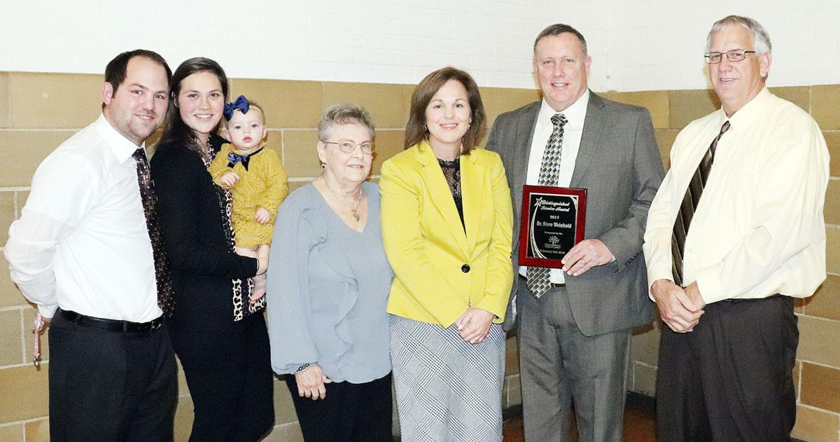 Honored for Distinguished Service