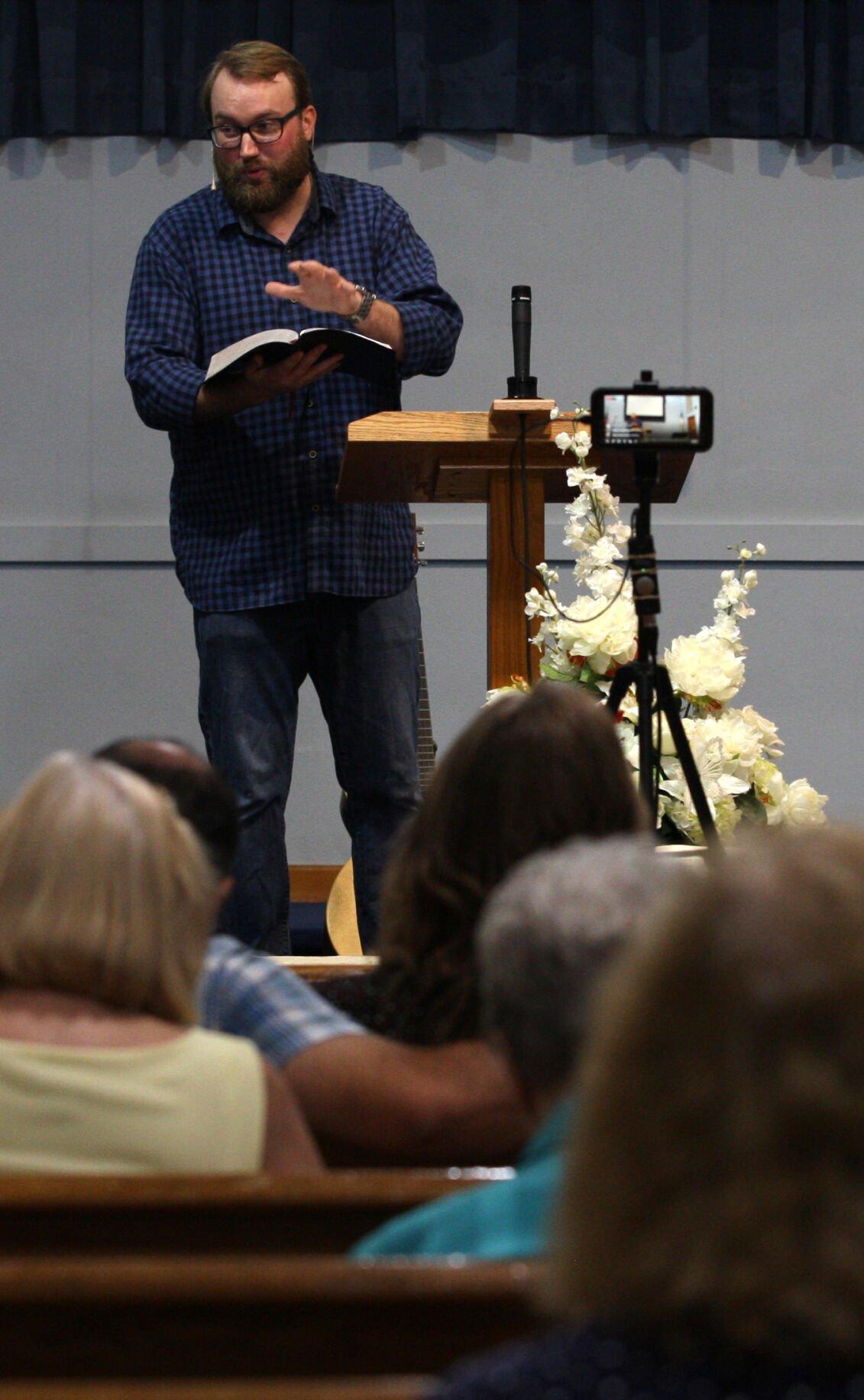 Pastor Tommy Schmitt preaches