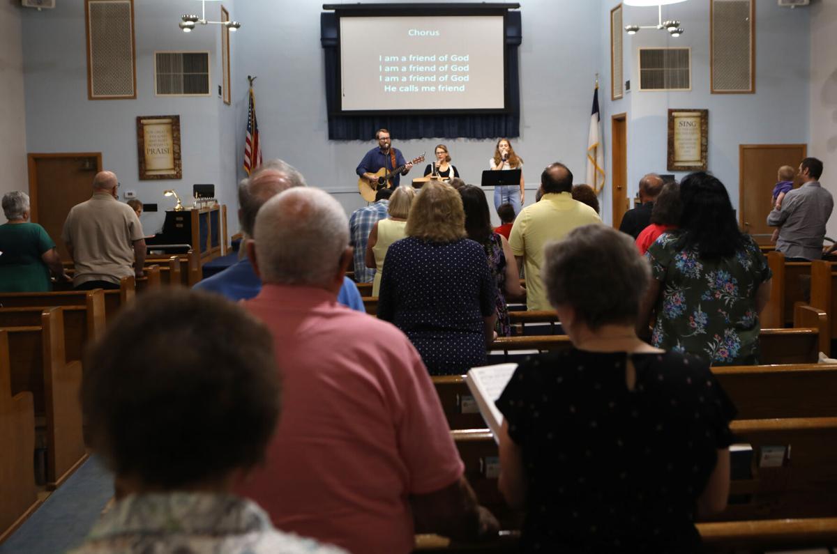 Congregants worship at First Baptist Church