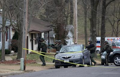 Franklin County SWAT team walks toward a home