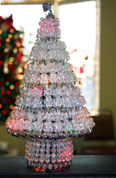 crystal christmas tree at salon gets new lights