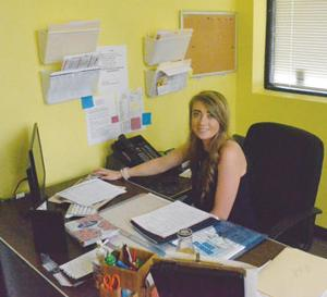 <p>Darian Liles works at her desk Monday morning. She is the new Advertising Director for the Independent-Messenger.</p>