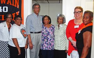 <p>Some of the members of the James Solomon Russell/Saint Paul's College Museum and Archives Board of Directors pose with Clifton and Jean McClenney, who attended the open house. McClenney is the son of the late Earl H. McClenney, Sr., former President of Saint Paul's College. Regina Gordon, left, Gloria Wesson Menyweather-Woods, Clifton McClenney, Jean McClenney, Barbara Whitehurst-Malone, Teya Whitehead and Carolyn Lofton.</p>