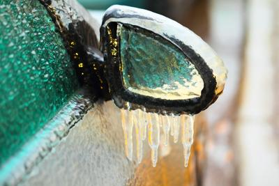 Car,Side,Mirror,Covered,With,Ice,And,Icicles,,Close,Up